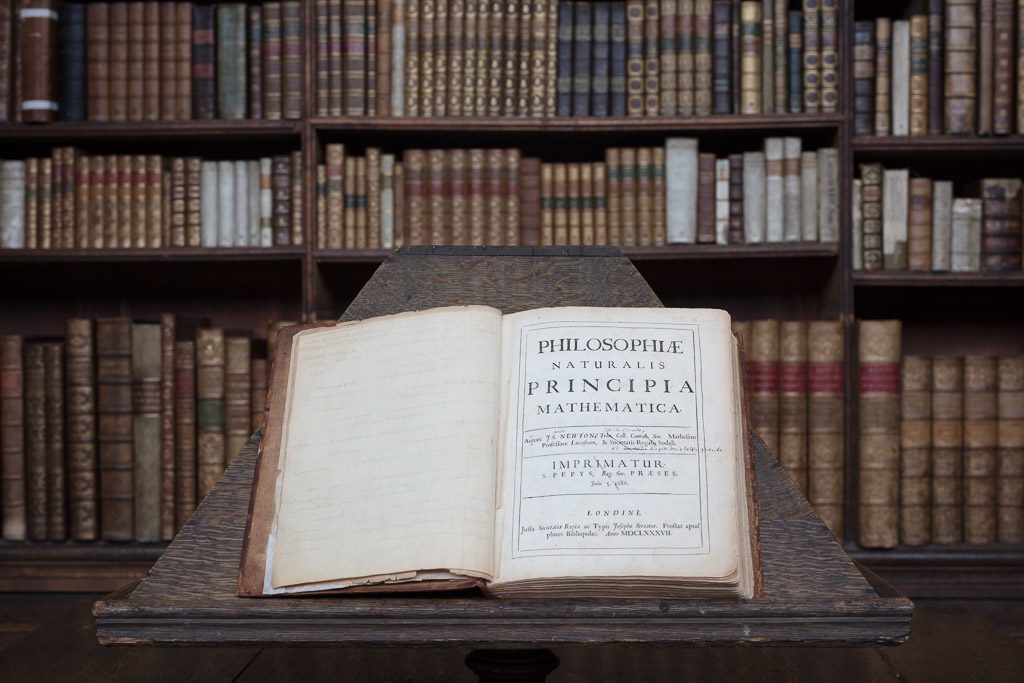 The Philosophiæ Naturalis Principia Mathematica (The Principia for short) by Isaac Newton in the Wren Library, Trinity College, Cambridge
