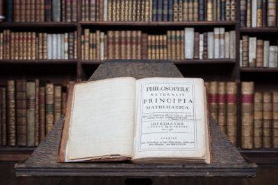 Isaac Newton's personal copy of the Principia in the Wren Library. Newton used this copy to make corrections for the second edition. It is from this book that the images were created to design the Newton Scarf.